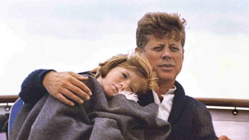 Early years: Caroline Kennedy and her father, President John F. Kennedy, sit on a yacht on Hyannis Sound in Massachusetts
