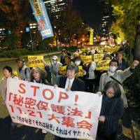 Not so secret: People protest the state secrecy bill Thursday night with a march through Tokyo's Kasumigaseki district. | KYODO