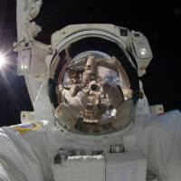 Japan Aerospace Exploration Agency astronaut Aki Hoshide uses a digital camera to take a 'selfie' during a September 2012 spacewalk. On Tuesday, Oxford Dictionaries, publisher of the Oxford English Dictionary, named selfie — a photo that one has taken of oneself, typically with a smartphone or webcam and then uploaded to a social media website — as its 2013 word of the year. | AP
