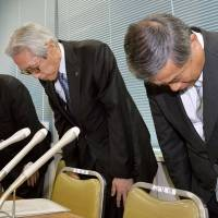 Spilling the beans: Takashimaya Co. executives bow in apology Tuesday in Tokyo after admitting that company restaurants and stores misrepresented items on their menus | KYODO