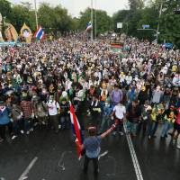 Civil disobedience?: Anti-government protesters holding Thai national flags gather at a rally in Bangkok on Monday. | AP