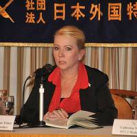 Catherine Fisher, the victim of a 2002 rape by an American serviceman near the U.S. Navy base in Yokosuka, talks about her court battle during a news conference Thursday at the Foreign Correspondents' Club of Japan in Tokyo. | COURTESY OF FCCJ