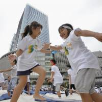 Keeping fit: Children take part in an annual sporting event at Grand Front Osaka in the Kinki capital on June 23. | KYODO