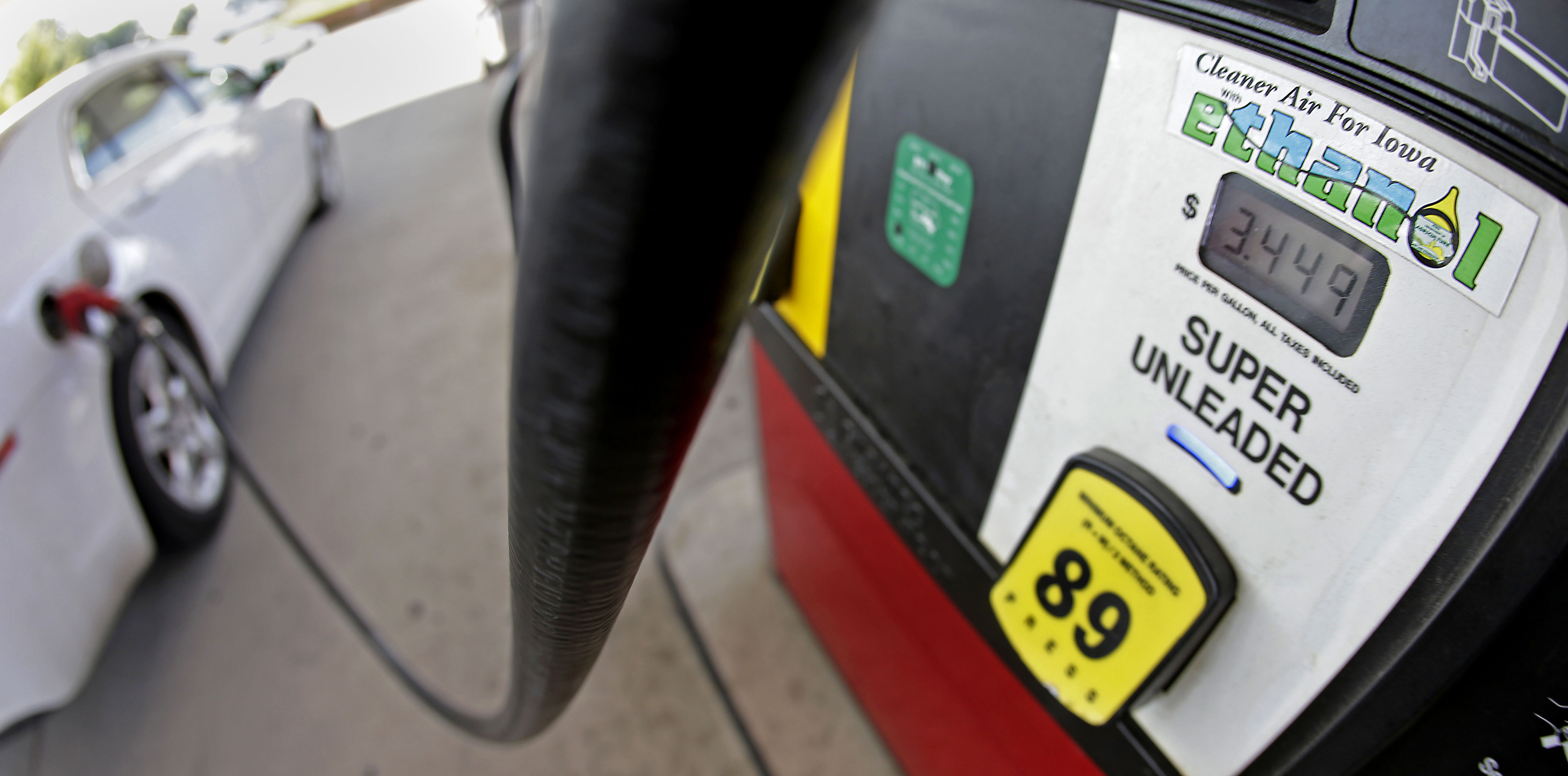 What's the solution?: A motorist fills up with gasoline containing ethanol in Des Moines, Iowa   AP