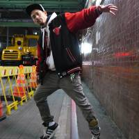 Fancy footwork: Takuya Harashima, who goes by his first name as a dancer, shows off the championship footwork leg belt he won at Battle Train Tokyo. The event was the country's first official footwork dancing competition. | ARNI KRISTJANSSON