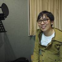 Aiming high: Inhyeok Yeo sits in a recording studio in Tokyo. The 26-year-old singer has set his sights on winning a Grammy Award.   TOMOKO OTAKE