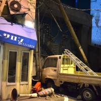 Real enough: This simulation of an earthquake's aftermath at the Tokyo Rinkai Disaster Prevention Park may use projections and sound effects instead of real shattering windows, but the effect is jarring.   JASON JENKINS