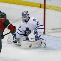 Wild style: Minnesota's Zach Parise scores on Toronto goalie Jonathan Bernier in the shootout of the Wild's 2-1 win over the Maple Leafs on Wednesday. | AP