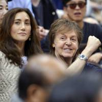 Get him: Paul McCartney takes in the action on the fifth day of the Kyushu Grand Sumo Tournament on Thursday in Fukuoka. | KYODO