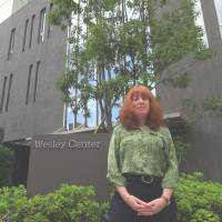 Offering support for expats:  Vickie Skorji, the new director of  Tokyo English Life Line's hot-line service, stands outside  the nonprofit group's offices in the Wesley Center, Minami Aoyama, in  Tokyo's Minato Ward | GIANNI SIMONE