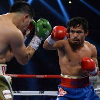 Meeting of the minds: Manny Pacquiao (right) defeated Brandon Rios in their bout on Sunday in Macau. | AP