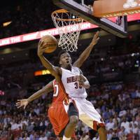 Hang time: Miami's Norris Cole goes up for a shot against Atlanta's Jeff Teague in the first half on Tuesday night. The Heat beat the Hawks 104-88. | AP