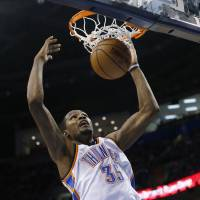 Rolling Thunder: Oklahoma City's Kevin Durant dunks during the Thunder's 105-91 win over the Clippers on Thursday. | AP
