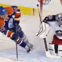 Easy catch: Columbus goalie Sergei Bobrovsky makes a save on Edmonton's Ales Hemsky in the second period on Tuesday. | AP