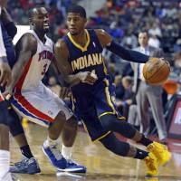 Smooth as silk: Indiana's Paul George drives on Detroit's Rodney Stuckey in first-half action on Tuesday night | AP