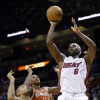 Hot hand: Miami's LeBron James shoots during the Heat's 118-95 win over the Bucks on Tuesday   AP