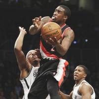 Streak continues: Portland's Wesley Matthews goes up for a shot against Brooklyn's Paul Pierce in the second half on Monday night. The Blazers beat the Nets 108-98. | AP