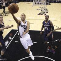 Swoop to the hoop: San Antonio's Tony Parker goes up for a shot against New Orleans in the first half on Monday. The Spurs routed the Pelicans 112-93. | AP