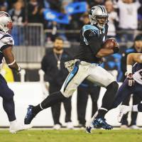 Dynamic: Carolina QB Cam Newton scrambles between New England's Dont'a Hightower (left) and Nate Ebner on Monday night. | AP