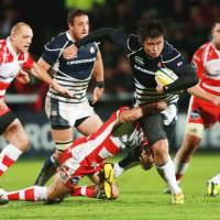 Learning curve: Japan's Shinya Makabe is tackled by Gloucester's Andy Hazell during the English team's 40-5 win at Kingsholm Stadium on Tuesday | AP