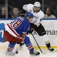 Ice battle: Anaheim's Emerson Etem (65) and New York's Marc Staal (18) vie for control of the puck on Monday night. The Ducks edged the Rangers 2-1 | AP