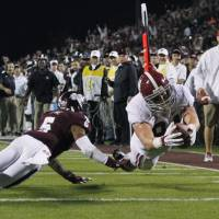 Full extension: Alabama's Brian Vogler dives into the end zone on an 18-yard touchdown against Mississippi State on Saturday   AP
