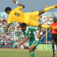 Over the top: Ethiopia's Hajlu Aynalem leaps over Nigeria's Ahmed Musa in their World Cup qualifier on Saturday. Nigeria won 2-0 and advanced 4-1 on aggregate | AFP-JIJI