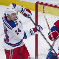 Look out: Montreal goalie Carey Price makes a save as New York's Ryan Callahan swings for the puck on Saturday night | AP