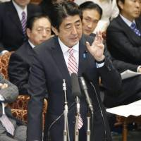 Ante upped: Prime Minister Shinzo Abe fields questions Monday at the Upper House Budget Committee regarding China's creation of an air defense identification zone that covers airspace over the Senkaku Islands. | KYODO