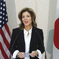Ready for work: Caroline Kennedy, the new U.S. ambassador to Japan, speaks to reporters after arriving at Narita International Airport on Friday.    BLOOMBERG