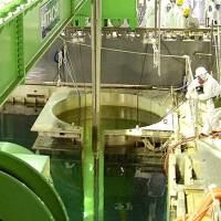 In a hole: A file photo shows workers removing spent nuclear fuel rods at the Fukushima No. 1 plant on Monday. | TEPCO/KYODO