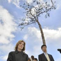 Legacy  of 3/11: U.S. Ambassador to Japan Caroline Kennedy faces reporters Tuesday next to the 'miracle pine' that withstood the tsunami in Rikuzentakata, Iwate Prefecture. | KYODO
