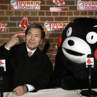 Heavy hitters: Kumamoto Gov. Ikuo Kabashima and Kumamon, the prefecture's popular black bear 'yuru-kyara' mascot, field questions from members of the media during a visit to Fenway Park, home of the Boston Red Sox baseball team, Tuesday | AP