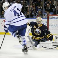 That won't work: Toronto's Nikolai Kulemin (41) has the puck hit his skate as he tries to screen Buffalo Sabres' Ryan Miller during the second period on Friday. | AP
