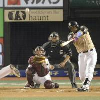 The new wave: Michel Abreu (right) had a solid season for the Hokkaido Nippon Ham Fighters in 2013. | KYODO