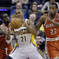 <B>Give me some space: The Pacers' David West (center) is fouled by Bucks forwards Ekpe Udoh (left)  and Khris Middleton on Friday in Indianapolis | INDIANA DEFEATED MILWAUKEE <A HREF='HTTP://104-77.AP' TARGET='_BLANK'>104-77.AP</A></B>