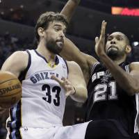 Total concentration: Spurs big man Tim Duncan defends the Grizzlies' Marc Gasol in first-half action on Friday in Memphis. | AP