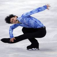 <B>Round and round he goes: Yuzuru Hanyu sits second after the men's short <A HREF='http://program.KYODO' TARGET='_blank'>program.KYODO</A></B>