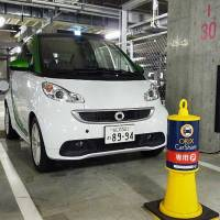 Charged up: Orix Auto Corp. has wedged a Smart electric vehicle from Daimler into its car sharing lineup in Osaka. | KYODO