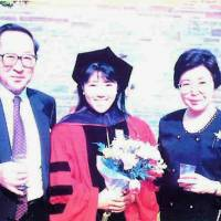 Chino stands between her father, Tetsuo, and mother, Tomoko, during graduation at Cornell University Law School in 1991 | COURTESY OF MITSURU CHINO
