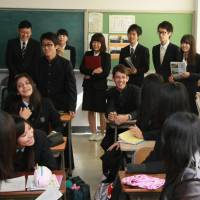 Laying the foundation: Aichi Prefectural University students in the back row observe an English class at Koromodai High School in Toyota, Aichi Prefecture. | CHUNICHI SHIMBUN