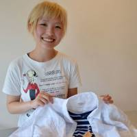 Fashion maven: A stylist (top) coordinates clothing for a user of the bemool online styling service.  | KYODO