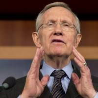 Majority rule: Senate Majority Leader Harry Reid speaks to reporters after the Senate passed a major rules change Thursday. | AP