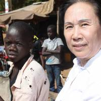 On the ballot: Chinese-born Malian Yu Hong Wei, who is also known as Astan Coulibaly, is seen Friday in Segou, where she has lived since 1982 and is now a candidate for the upcoming parliamentary elections in Mali | AFP-JIJI