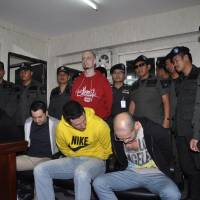 Busted: Drug-smuggling suspects (front, from left) Slovak Alexander Lnu, Filipino Kelly Allan Reyes Peralta, Briton Philip Shackels, Taiwanese Ye Tiong Tan Lim and (second row, center left) Briton Scott Stammers are escorted by Thai police at the Crime Suppression Division in Bangkok on Nov. 19. | AP