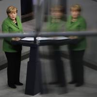 Friend or foe?: German Chancellor Angela Merkel delivers a speech on allegations of a massive spying program by the U.S. National Security Agency at the Bundestag in Berlin on Monday | AP
