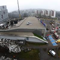 'Crime' scene: The Maxima supermarket in Riga is shown Saturday, two days after its roof caved in. | AP