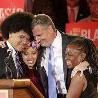 Symbolic victory: New York Democratic mayoral candidate Bill de Blasio embraces his children, Dante (left) and Chiara (second from left), and his wife, Chirlane McCray, after polls closed in the city's primary election on Sept. 10 | AP