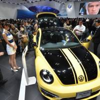 Top gear: Visitors view a Volkswagen Beetle Racer at the Tokyo Motor Show on Sunday. German carmakers and Sweden's Volvo have made steady inroads in Japan, accounting for about 75 percent of all foreign cars sold in the country. | AFP-JIJI