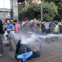 Dousing the ire: Egyptian police fire water cannons to disperse a protest by secular anti-government activists in Cairo on Tuesday. | AP